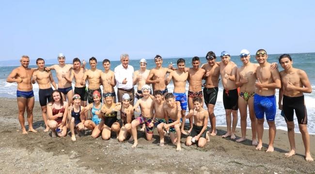Güzelbahçe'nin Mavi Bayraklı Plajı'nda Milli Sporcular Yetişiyor